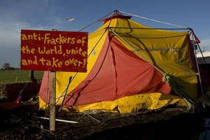 "Photo - A sign is seen outside a tent in an anti-fracking protest camp by an exploratory drill site for the controversial gas extraction process at Barton Moss in Manchester, England, Monday, Jan. 13, 2014.  Councils that back ""fracking"" will get to keep more money in tax revenue as part of an ""all-out"" drive to promote drilling, Prime Minister David Cameron has said. (AP Photo/Jon Super)"