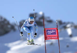 Photo - Julia Mancuso, of the United States, competes during an alpine ski World Cup women's downhill, in Altenmarkt Zauchensee, Austria, Saturday, Jan. 11 , 2013. (AP Photo/Marco Trovati)