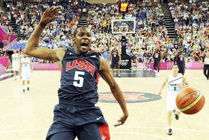 photo - Thunder forward Kevin Durant jumps for the ball during the Summer Olympics. Durant, along James Harden, Russell Westbrook and Serge Ibaka will likely see limited action this preseason after their summer in the Olympics. AP Photo