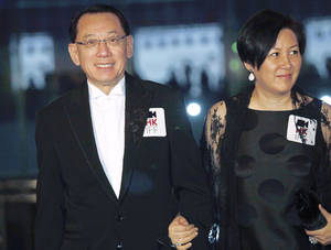 """Photo - FILE - In this March 22, 2009 file photo, Albert Yeung, left, chairman of the Hong Kong media conglomerate Emperor Entertainment Group and his wife attend the premiere of his film """" Shinjuku Incident """" as part of the kickoff for The 33rd Hong Kong International Film Festival  in Hong Kong. A court has ruled that the Hong Kong tycoon can sue Google over its autocomplete results suggesting he has links to organized crime. In a judgment released Wednesday, Aug. 6, 2014,  the court dismissed the Internet search giant's objections to tycoon Albert Yeung's defamation lawsuit.(AP Photo/Vincent Yu, File)"""