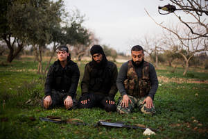 Photo - FSA fighters pray after an attack on a Military Academy in Tal Sheer village, north of Aleppo province, Syria, Thursday, Dec 13, 2012. (AP Photo / Manu Brabo)   ORG XMIT: MB117