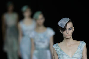 Photo -   Models wear creations part of the Giorgio Armani women's Spring-Summer 2013 collection that was presented in Milan, Italy, Sunday, Sept. 23, 2012. (AP Photo/Luca Bruno)