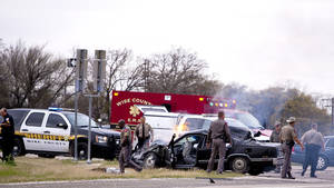 photo - Emergency personnel are on the scene of a crash and shootout with police involving the driver of a black Cadillac with Colorado plates in Decatur, Texas, Thursday, March 21, 2013. The driver led police on a gunfire-filled chase through rural Montague County, crashed his car into a truck in Decatur, opened fire on authorities and was shot, officials said.  Texas authorities are checking whether the Cadillac is the same car spotted near the home of Colorado prisons chief Tom Clements, who was shot and killed when he answered the door Tuesday night. (AP Photo/Wise County Messenger, Jimmy Alford) MANDATORY CREDIT, MAGS OUT