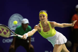 photo - Maria Kirilenko of Russia returns a shot against Sorana Cirstea of Romania  during their semifinal tennis match at the Pattaya Open tennis in Pattaya, Thailand, Saturday, Feb. 2, 2013. (AP Photo/Sakchai Lalit)