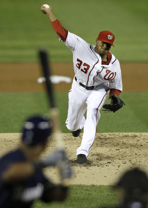 Photo -   Washington Nationals starting pitcher Edwin Jackson delivers against the Milwaukee Brewers during the second inning of a baseball game at Nationals Park in Washington on Friday, Sept. 21, 2012. (AP Photo/Jacquelyn Martin)