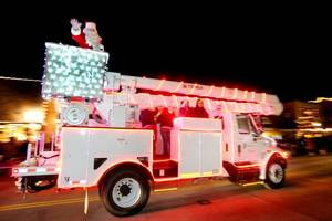 Photo - Santa Claus travels in a bucket truck during a past Edmond Electric Parade of Lights. This year's parade is scheduled for Dec. 1. PHOTO BY STEVE GOOCH, OKLAHOMAN ARCHIVES