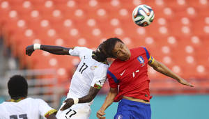 Photo - Ghana' Mohammed Rabiu (17) and South Korea's Jacheol Koo (17) fight for the ball during the first half of an international  friendly soccer match in Miami Gardens, Fla., Monday, June 9, 2014. ( AP Photo/J Pat Carter)