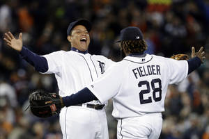 Photo -   Detroit Tigers' Miguel Cabrera, left, and Prince Fielder (28) celebrate their 5-4 win over the Kansas City Royals in a baseball game in Detroit, Wednesday, Sept. 26, 2012. (AP Photo/Paul Sancya)