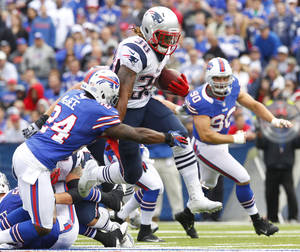 photo -   New England Patriots' Brandon Bolden (38) tries to run through the tackle of Buffalo Bills' Terrence McGee (24) during the second half of an NFL football game in Orchard Park, N.Y., Sunday, Sept. 30, 2012. (AP Photo/Bill Wippert)