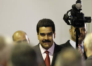 Photo -   Venezuela's long time Foreign Minster Nicolas Maduro attends a ceremony declaring President Hugo Chavez official winner of Sunday's presidential elections at the Electoral Council in Caracas, Venezuela, Wednesday, Oct. 10, 2012. During the event Chavez announced he was naming Maduro as new vice president. (AP Photo/Ariana Cubillos)