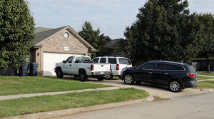 photo - Neighbors identified a house at 12916 S Robinson as the home of an Oklahoma City police officer.  PHOTO BY STEVE SISNEY, THE OKLAHOMAN