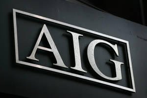 Photo - FILE - In this Sept. 17, 2008 file photo, the AIG logo is shown in New York. American International Group Inc. says it will sell up to 90 percent of its airplane leasing unit International Lease Finance Corp. to an investor group led by Weng Xianding, chairman of New China Trust Co. Ltd., for approximately $5.28 billion. (AP Photo/Mark Lennihan, File)