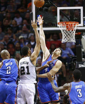 Photo - San Antonio's Tim Duncan (21) puts up a shot between Oklahoma City's Caron Butler (2), Nick Collison (4), and Perry Jones (3) during Game 2 of the Western Conference Finals in the NBA playoffs between the Oklahoma City Thunder and the San Antonio Spurs at the AT&T Center in San Antonio, Wednesday, May 21, 2014. Photo by Sarah Phipps, The Oklahoman