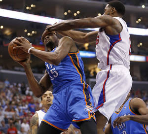 Photo - Oklahoma City's Kevin Durant (35) is fouled by Los Angeles' DeAndre Jordan (6) during Game 4 of the Western Conference semifinals in the NBA playoffs between the Oklahoma City Thunder and the Los Angeles Clippers at the Staples Center in Los Angeles, Sunday, May 11, 2014. Photo by Nate Billings, The Oklahoman