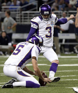 Photo - Minnesota Vikings kicker Blair Walsh (3) kicks a 38-yard field goal as Chris Kluwe holds during the second quarter of an NFL football game against the St. Louis Rams Sunday, Dec. 16, 2012, in St. Louis. (AP Photo/Tom Gannam)