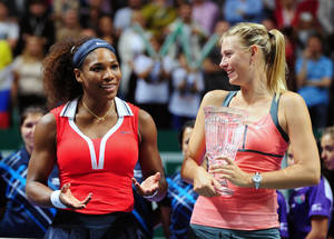 Photo -   Serena Williams of the U.S., left, after her tennis victory against Maria Sharapova of Russia, right, on the final of the WTA Championships in Istanbul, Turkey, Sunday, Oct. 28, 2012. (AP Photo)