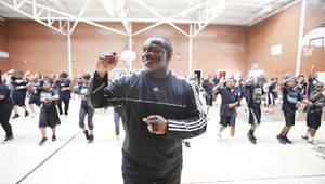 "Photo - Northeast Academy coach Kenny Blair leads students in the ""Let's Move"" fitness event in Oklahoma City on Thursday. Photos By Steve Gooch, The Oklahoman"