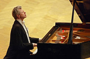 photo - FILE - This Sept. 21, 2004 file photo shows pianist Van Cliburn performing during at a concert dedicated to the memory of the victims of the recent Beslan school massacre in Moscow.  Cliburn, the internationally celebrated pianist whose triumph at a 1958 Moscow competition helped thaw the Cold War and launched a spectacular career that made him the rare classical musician to enjoy rock star status  died early Wednesday, Feb. 27, 2013, at his Fort Worth home following a battle with bone cancer.  He was 78. (AP Photo/Sergey Ponomarev, file)
