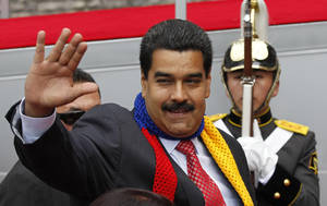 Photo - Venezuela's President Nicolas Maduro arrives to attend President Rafael Correa's swearing-in ceremony in Quito, Ecuador, Friday, May 24, 2013. Correa is starting a third term as president. (AP Photo/Dolores Ochoa)