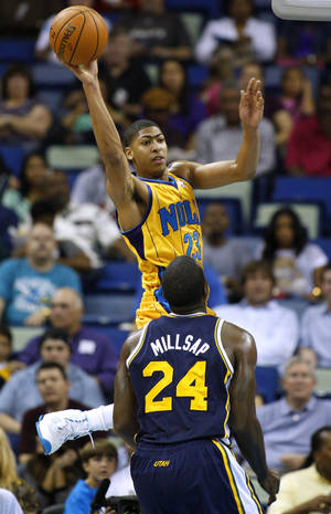 Photo -   New Orleans Hornets power forward Anthony Davis (23) passes the ball over Utah Jazz power forward Paul Millsap (24) during the first half of an NBA basketball game in New Orleans, Friday, Nov. 2, 2012. (AP Photo/Jonathan Bachman)