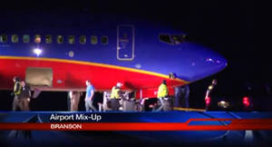 Photo - This frame grab provided by KSPR-TV shows a Southwest Airlines flight that was scheduled to arrive Sunday Jan. 12, 2014, at Branson Airport in southwest Missouri instead landed at an airport 7 miles north — with a runway about half the size of the intended destination. (AP Photo/KSPR-TV)