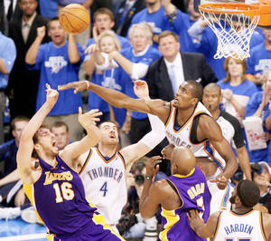 Photo - Oklahoma City's Serge Ibaka, right, and Nick Collison (4) defend Pau Gasol, left, of the Lakers during Thursday's game. Photo by Bryan Terry, The Oklahoman
