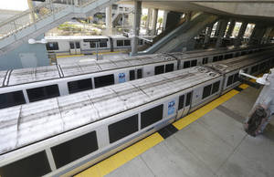 Photo - FIEL - In this Monday, July 1, 2013 file photo, Bay Area Rapid Transit trains are parked at the station in Millbrae, Calif. Commuter rail service is resuming Friday, July 5, 2013 in the San Francisco Bay area after unions called off a strike, agreeing with the transit agency to extend a labor contract for a month while they continue bargaining. Bay Area Rapid Transit will begin operating trains by 3 p.m. PDT Friday, ending a four-day strike that crippled commutes across the Bay Area, the state's secretary of the Labor and Workforce Development Agency, announced late Thursday, July 4, 2013. (AP Photo/Jeff Chiu)