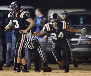 Photo - Josh Way (24) of Wayne celebrates a touchdown next to teammate Louden Johnson (3)  during a high school football playoff game between Wayne and Minco in Wayne, Okla., Friday, Nov. 25, 2011. Photo by Nate Billings, The Oklahoman