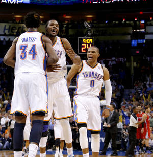 Photo - L.A. CLIPPERS / REACTION: Oklahoma City's Hasheem Thabeet (34), Kevin Durant (35), and Russell Westbrook (0) react during an NBA basketball game between the Oklahoma City Thunder and the Los Angeles Clippers at Chesapeake Energy Arena in Oklahoma City, Wednesday, Nov. 21, 2012. Photo by Bryan Terry, The Oklahoman