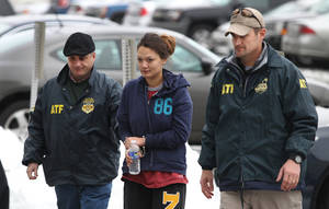 photo - Dawn Nguyen is escorted into the Federal Building, Friday, Dec. 28, 2012, in Rochester, N.Y., and charged in connection with the guns used in the Christmas Eve ambush slaying of two volunteer firefighters responding to a house fire in Webster, N.Y. (AP Photo/Democrat & Chronicle, Jamie Germano) MAGS OUT; NO SALES; MANDATORY CREDIT; INTERNET OUT