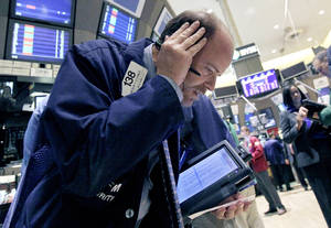 photo -   FILE - In this Oct. 9, 2012, file photo, trader Andrew O'Connor works on the floor of the New York Stock Exchange. After three straight days of losses for major stock indexes, investors appeared to be looking for bargains Thursday. (AP Photo/Richard Drew, File)