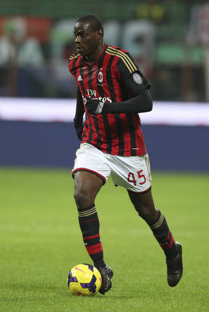 """Photo - In this picture taken  Saturday, Nov. 23, 2013, AC Milan forward Mario Balotelli controls the ball during a Serie A soccer match between AC Milan and Genoa, at the San Siro stadium in Milan, Italy. Liverpool could be about to replace one controversial striker with another.  Italy international Mario Balotelli has been lined up by the Premier League club as a potential replacement for Luis Suarez, who left Anfield to join Barcelona for $130 million. Balotelli, who spent 2½ years with Manchester City up to 2013, left the club's Milanello training ground on Thursday, Aug. 21, 2014, for possibly the last time. """"Mario Balotelli left Milanello's sporting center at 1330 (local time) after saying goodbye to his teammates,"""" Milan said in a statement. """"Before going through the gates, he said goodbye to members of Milan's press office."""" (AP Photo/Luca Bruno)"""