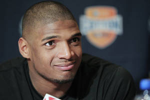 Photo - FILE - In this Jan. 1, 2014, file photo, Missouri senior defensive lineman Michael Sam speaks to the media during an NCAA college football news conference in Irving, Texas. Sam says he is gay, and he could become the first openly homosexual player in the NFL. (AP Photo/Brandon Wade, File)