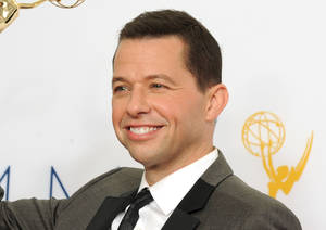 "Photo - FILE - This Sept. 23, 2012 file photo shows actor Jon Cryer, backstage at the 64th Primetime Emmy Awards in Los Angeles. Cryer, an actor who knows a thing or two about Charlie Sheen and Demi Moore among others, is working on a ""candid"" memoir. The Emmy-winning star of ""Two and a Half Men"" has a deal with New American Library, an imprint of Penguin Random House. The publisher announced Wednesday that the book, currently untitled, is scheduled for next spring. (Photo by Jordan Strauss/Invision/AP, File)"