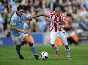photo -   Stoke City's Michael Kightly, right, and Manchester City's Gareth Barry battle for the ball during their English Premier League soccer match at the Britannia Stadium in Stoke-on-Trent, England, Saturday Sept. 15, 2012. (AP Photo/Clint Hughes)