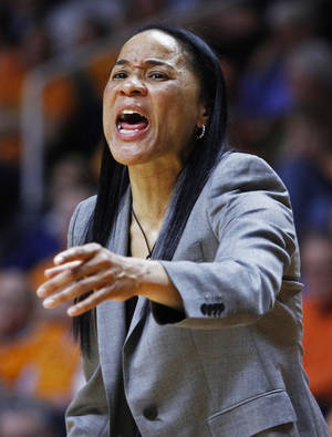 Photo - South Carolina coach Dawn Staley yells to her team in the second half of an NCAA college basketball game against Tennessee on Sunday, March 2, 2014, in Knoxville, Tenn. Tennessee won 73-61. (AP Photo/Wade Payne)