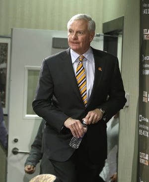 "Photo - Cleveland Browns owner Jimmy Haslam enters a news conference on the firing of head coach Rob Chudzinski at the Browns training facility Monday, Dec. 30, 2013, in Berea, Ohio. Haslam admitted hiring Chudzinski was a failure and vowed to ""get it right"" when he hires his next coach. (AP Photo/Tony Dejak)"