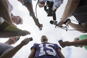 Photo - Kansas State quarterback Jake Waters is interviewed by reporters during Kansas State's media day on Monday, Aug. 5, 2013 in Manhattan, Kan. Waters, a junior college transfer, will compete for the starting quarterback job. (AP Photo/The Wichita Eagle, Travis Heying) ORG XMIT: KSWIE101