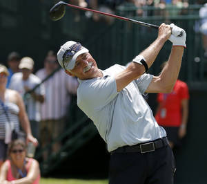 Photo - Mark Gardiner watches his ball after hitting for a crowd gathered during an exhibition with the Folds of Honor Foundation during the U.S. Senior Open at Oak Tree National in Edmond, Okla., Tuesday, July 8, 2014. Photo by Bryan Terry, The Oklahoman