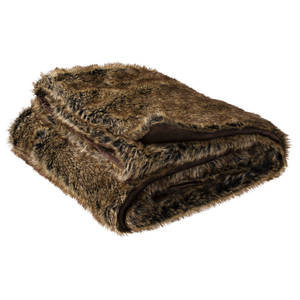 "Photo - This undated image provided by Target shows the Threshold Faux Fur Throw in Brown. From faux fur coats to ""vegan leather"" accents, faux fur gifts are trending, in 2013. (AP Photo/Target, Paul Weber)"