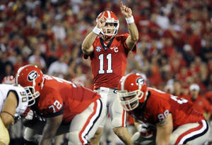 photo -   FILE - In this Sept. 22, 2012, fil ephoto, Georgia quarterback Aaron Murray (11) signals at the line of scrimmage during the second quarter of an NCAA college football game against Vanderbilt in Athens, Ga. Georgia's offense has been largely unstoppable, averaging nearly 50 points over its first five games. But now they face their toughest challenge yet, taking on No. 6 South Carolina and nemesis Steve Spurrier on Saturday. (AP Photo/John Amis, File)