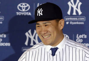 Photo - New York Yankees pitcher Masahiro Tanaka, of Japan, speaks during a news conference at Yankee Stadium Tuesday, Feb. 11, 2014, in New York.  (AP Photo/Frank Franklin II)