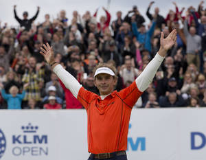 Photo - Joost Luiten of The Netherlands celebrates winning the KLM Open men's golf tournament in the beach resort of Zandvoort, western Netherlands, Sunday, Sept. 15, 2013. (AP Photo/Peter Dejong)
