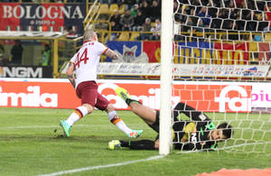 Photo - AS Roma's  Radja Nainggolan scores a goal during the Italian Serie A soccer match between Bologna and Roma at Renato Dall' Ara stadium in Bologna, Italy, Saturday, Feb. 22, 2014. (AP Photo/Studio FN)