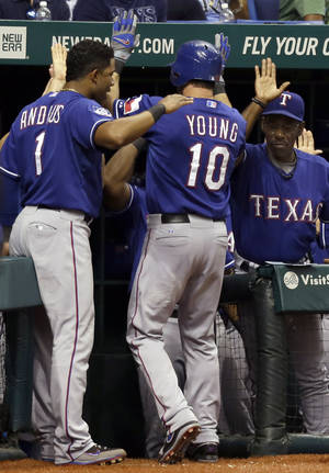 Photo -   Texas Rangers' Michael Young (10) gets congratulations from teammate Elvis Andrus (1) and manager Ron Washington (38) after hitting a fifth-inning home run off Tampa Bay Rays starting pitcher Jeremy Hellickson during a baseball game Friday, Sept. 7, 2012, in St. Petersburg, Fla. (AP Photo/Chris O'Meara)