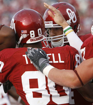 Photo - Oklahoma's Sam Bradford celebrates with Adron Tennell (80) after a touchdown reception Saturday in OU's 33-7 victory over Baylor. Photo by Chris Landsberger, The Oklahoman.