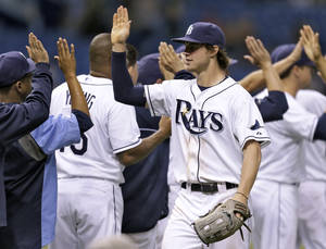 Photo - Tampa Bay Rays right fielder Wil Myers high fives teammates after the Rays defeated the Texas Rangers 6-2 during a baseball game Monday, Sept. 16, 2013, in St. Petersburg, Fla. (AP Photo/Chris O'Meara)