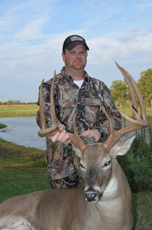 photo - Paul Powers of Duncan bagged a big buck on Monday's opening day of archery season. Powers, a member of the pro staff of Final Descent Outdoors, arrowed the buck in Stephens County after getting trail camera photos of the buck since August. Deer archery season continues through Jan. 15.  <strong>Photo provided</strong>