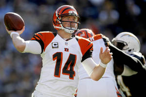Photo - Cincinnati Bengals quarterback Andy Dalton throws a pass against the San Diego Chargers during the first half of an NFL football game, Sunday, Dec. 2, 2012, in San Diego. (AP Photo/Lenny Ignelzi )