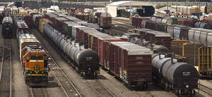 Photo -  Black tank cars used to transport crude oil from North Dakota are parked among other rail traffic at a train yard in Tacoma, Wash. AP File Photo  <strong>Lui Kit Wong -   </strong>